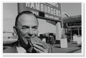 Ray Kroc in front of one of his restaurants.
